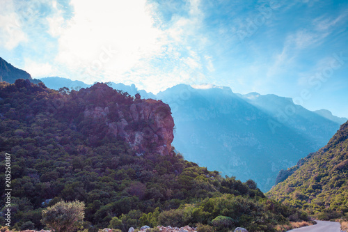 Fotobehang Aubergine Mountain cliffs against sky with clouds