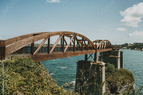 landscape with a wooden bridge over the sea in ribadeo, spain