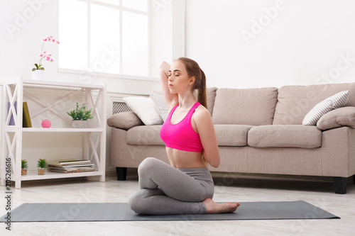Poster Woman training yoga in cow head pose.