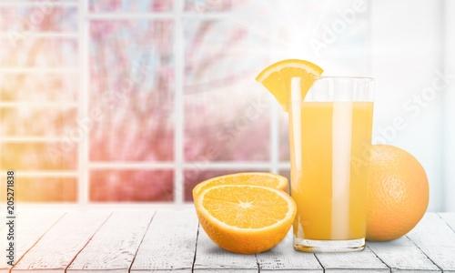 Orange Juice in glass on desk