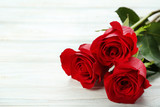 Bouquet of red roses on white wooden table - 205273054