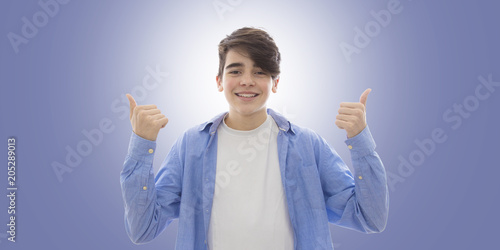 Fototapeta young man smiling with braces and thumbs up approval sign