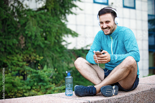 Fototapeta Man is relaxing after jogging