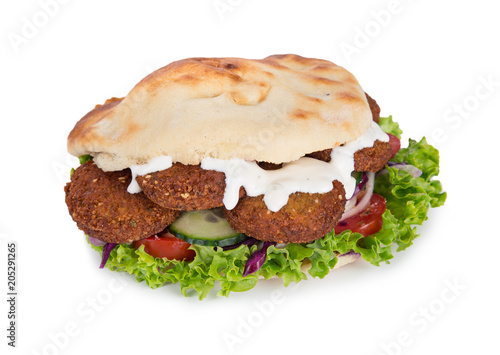 falafel with fresh vegetables in pita bread on white. - 205291265