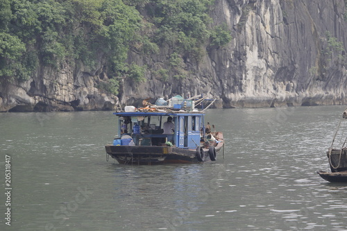 Canvas Schip Ha Long Bay , Vietnam-29 November 2014:Fishing boat in Ha long Bay, Panoramic view of sunset in Halong Bay, Vietnam, Southeast Asia,UNESCO World Heritage Site