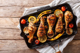 Freshly cooked grilled chicken drumstick legs with vegetables in a grill pan close-up. horizontal top view - 205324052