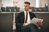 Serious businessman reading newspaper - 205324645