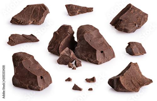 obraz lub plakat Pieces of dark chocolate isolated on white background.