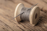 Fototapety spool of thread with a needle