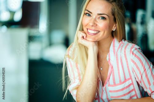 Leinwanddruck Bild Portrait of beautiful woman with long hair