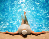Woman Relaxing In The Pool  - 205346413