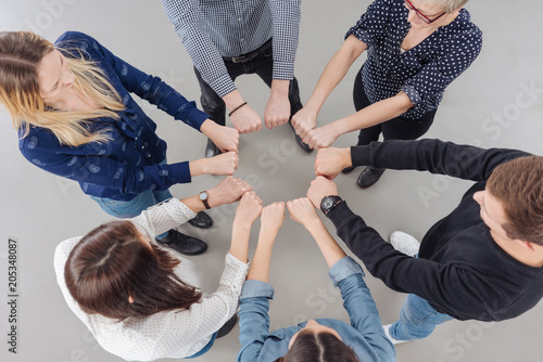 Fototapeta Team of diverse people make a motivational gesture