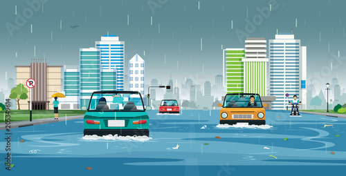 Wall mural Cars are running on flooded streets in the city.
