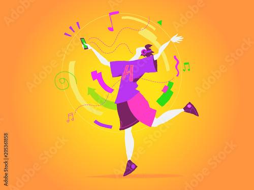 Fototapeta Un ragazzo balla al ritmo della musica del suo smartphone