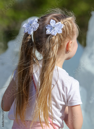 Tail of hair on a little girl
