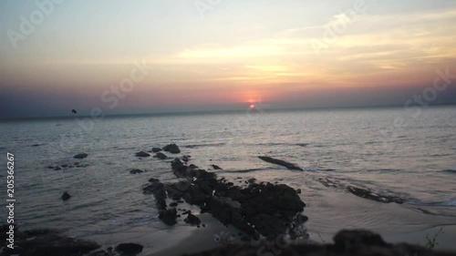 Dramatic tilted sunset on rocky Goa beach