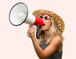 Quadro Young woman using sunglasses wearing summer hat communicates shouting loud holding a megaphone, expressing success and positive concept, idea for marketing or sales