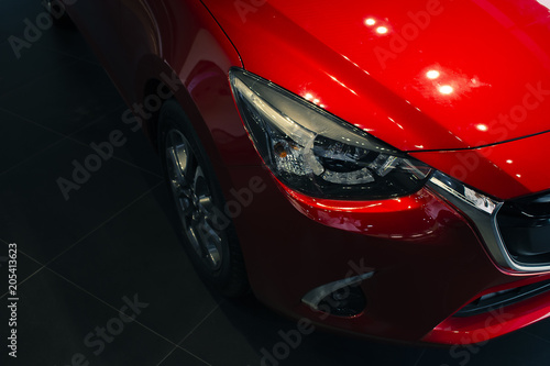 This Front car all new red color on room customer backbround parked in showroom of thailand for transport Illustrative editorial image. - 205413623