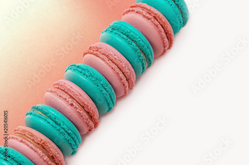 Fotobehang Macarons Diagonal line from pink and green macaroons. Minimal concepts. Delicate almond cookies. Space for copy. Top view.