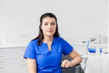 dentistry, medicine and healthcare concept - female dentist or nurse at dental clinic office