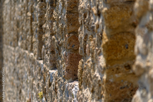 Fototapeta Fortress wall, stone, close-up.