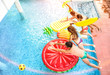 Top view of active friends jumping at swimming pool party - Vacation concept with happy guys and girls having fun in summer day at luxury resort - Dynamic young people on warm bright sunshine filter