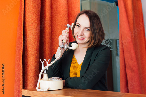 Woman calling on a retro phone