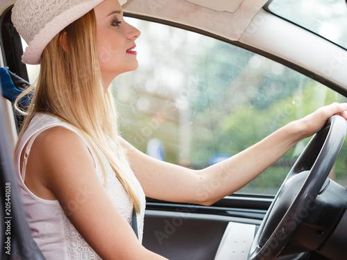 Wall mural Pretty woman driving her car