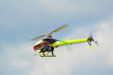 Homemade radio control helicopter  with electric motor on blue sky.