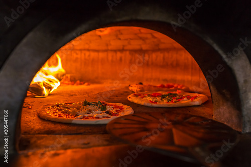 Plexiglas Pizzeria Original neapolitan pizza margherita in a traditional wood oven in Naples restaurant, Italy