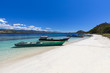 Quadro Boats on a white sand beach on a large Island in the Seventeen Island National Park, Flores, Indonesia.