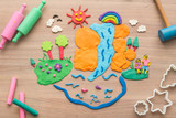 Kid's playing and creating toys from play dough and Molding clay. - 205460036
