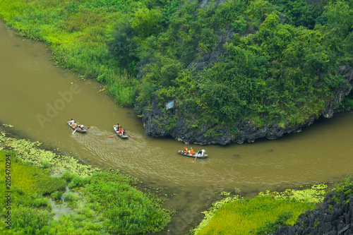 Plexiglas Pistache Yellow rice field on Ngo Dong river in Tam Coc Bich Dong from mountain top view in Ninh Binh province of Viet Nam