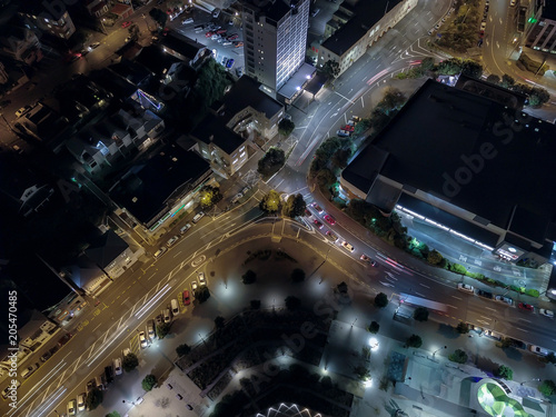 Wall mural Aerial, Car Light Streaks Around Small Roundabout