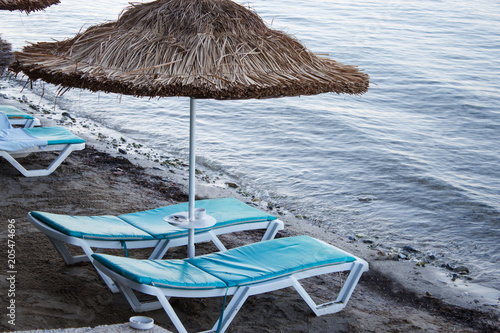 Sun loungers by the sea.