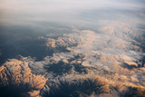 Snowy mountain range clouds white top view