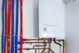 Pipes and boiler of gas heating system in the house - 205497205