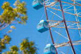 Blue ferris wheel on blue sky - 205509467
