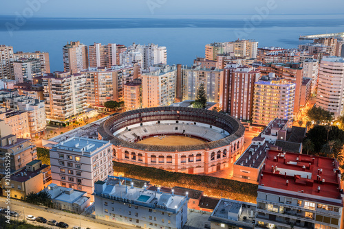 Malaga skyline with the bullring and residential buildings taken at the blue hour, Andalucia, Spain