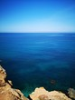 Rocky mediterranean seashore with azure and turquoise color water at Malta