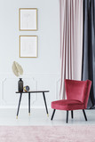 Burgundy chair by the table - 205523293