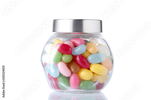 a glass jar full of colored candies with isolated on white background with clipping path