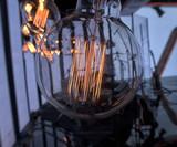 Light bulb incandescent hanging decorated interior room. - 205526225