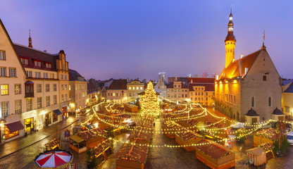Panoramic view of decorated and illuminated Christmas tree and Christmas Market at Town Hall Square or Raekoja plats, Tallinn, Estonia. Aerial view