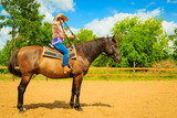 Cowgirl doing horse riding on countryside meadow - 205549016