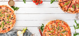 Set pizza. Italian cuisine. Top view. On a wooden background. Copy space. - 205566834