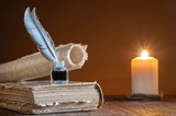Quill pen by candle light with old paper and books - 205567263