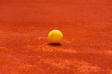 Tennis ball on clay court - 205575490