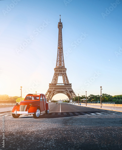 Fotobehang Eiffeltoren Paris street with view on the famous paris eiffel tower on a sunny day with some sunshine