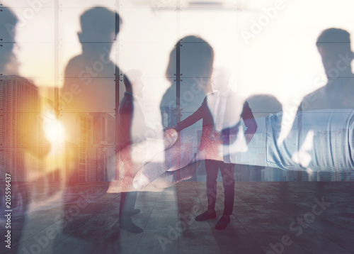Wall mural Handshaking business person in office. concept of teamwork and partnership. double exposure